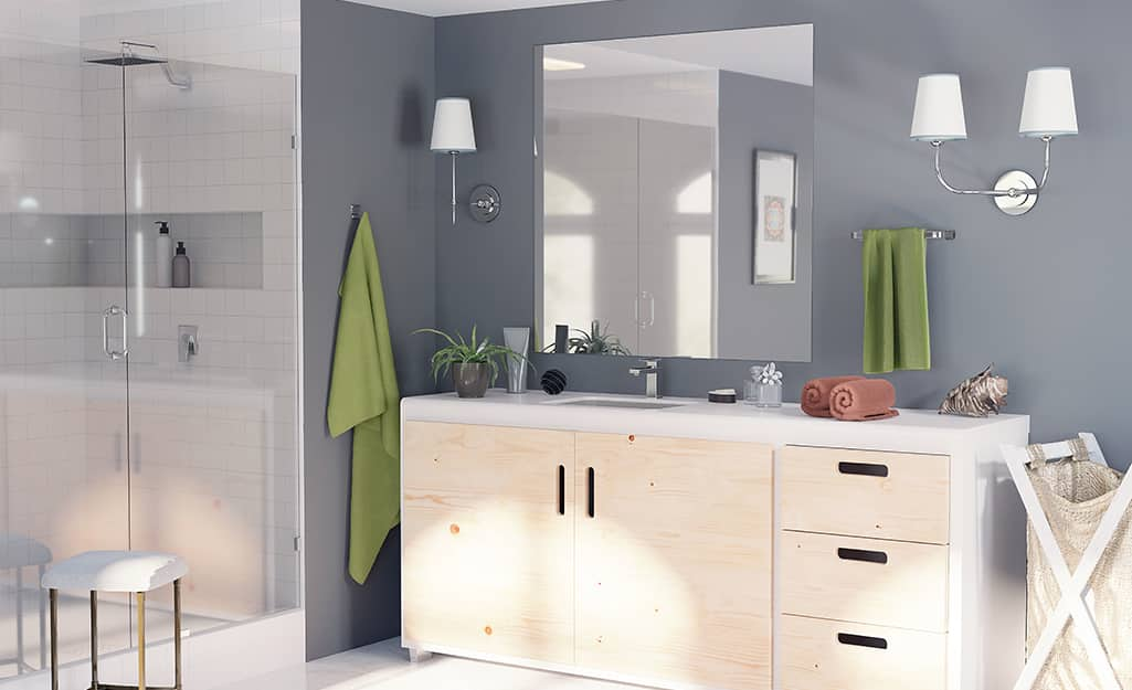 A large frameless mirror in a bathroom.