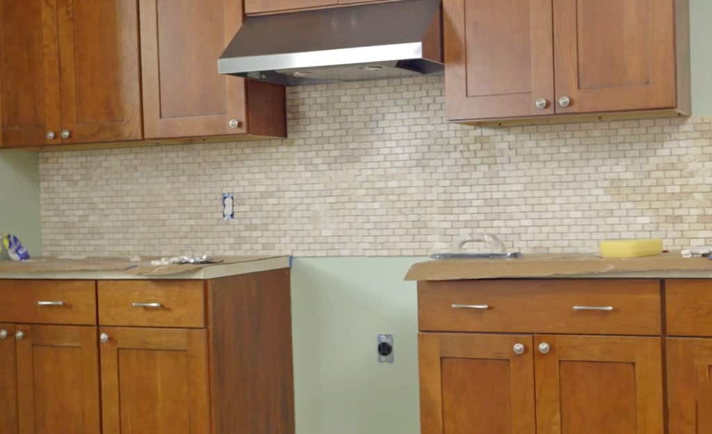 A kitchen wall featuring newly installed backsplash tile.