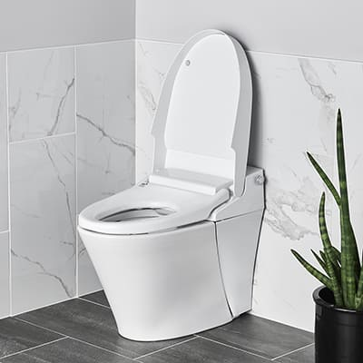 A white toilet is installed in a white bathroom.