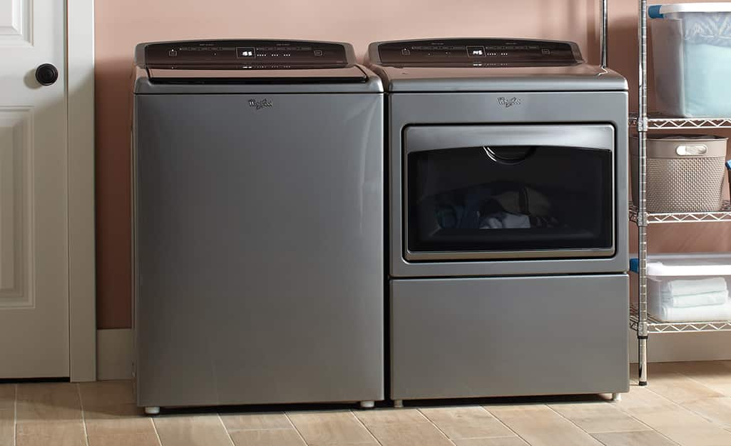 A washer and dryer with leveling feet in a laundry room.