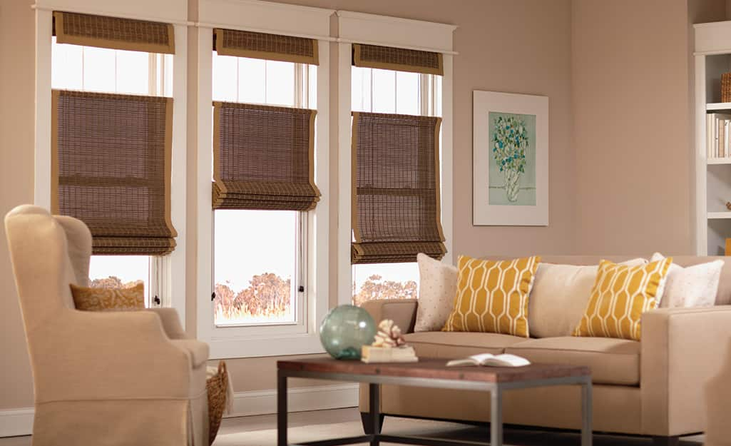 Woven shades on windows in a living space.