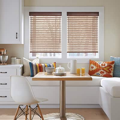 Blinds on a window in a dining nook.