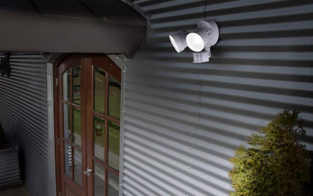 a set of flood lights on the exterior of a home near the front door