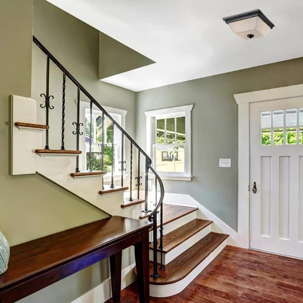 a home foyer with a flush mount light on the ceiling
