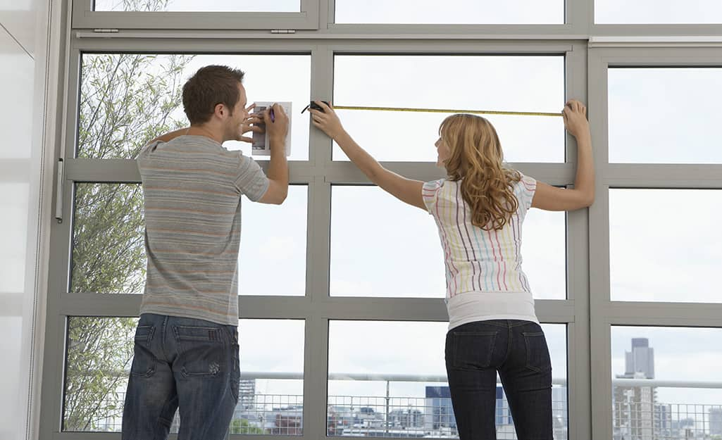 A couple measures windows for blinds.