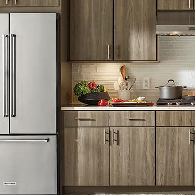Kitchen cabinets with wood finish.