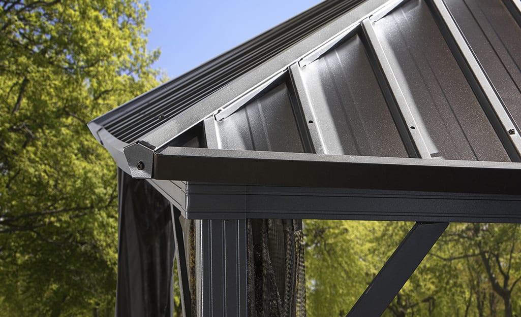 An aluminum roof installed on a patio.