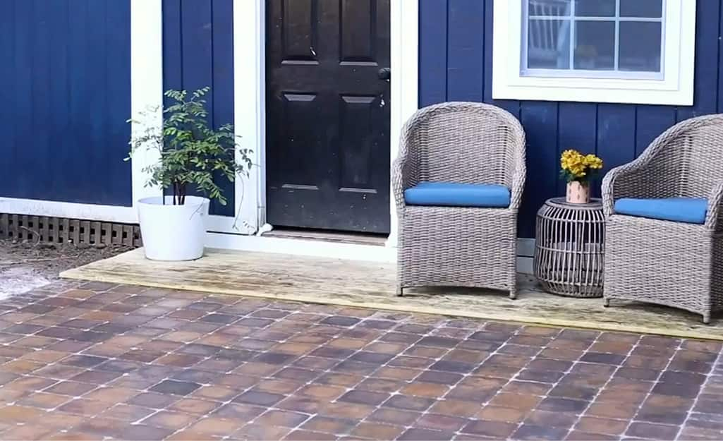 A porch is finished with patio pavers.