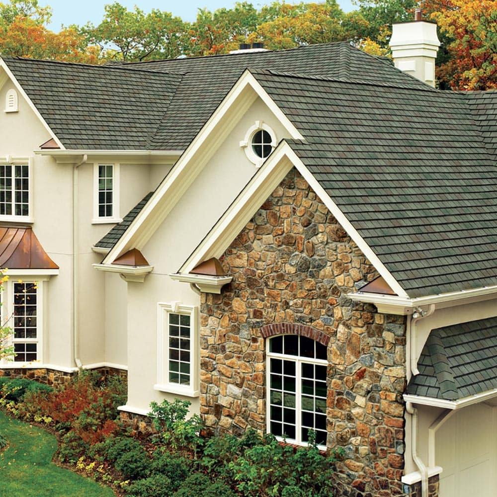 A newer home with a shingled roof.