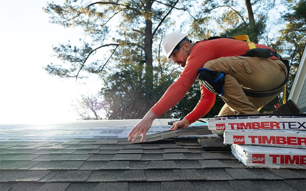 Person installing shingles.