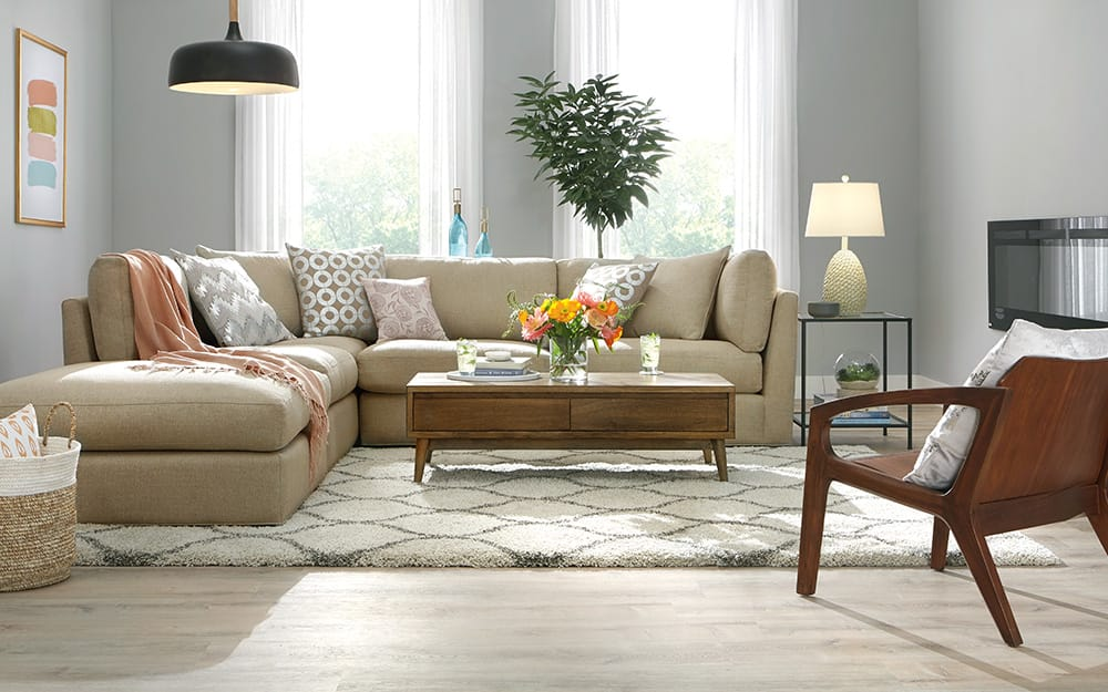 A living room with beautiful vinyl plank flooring.