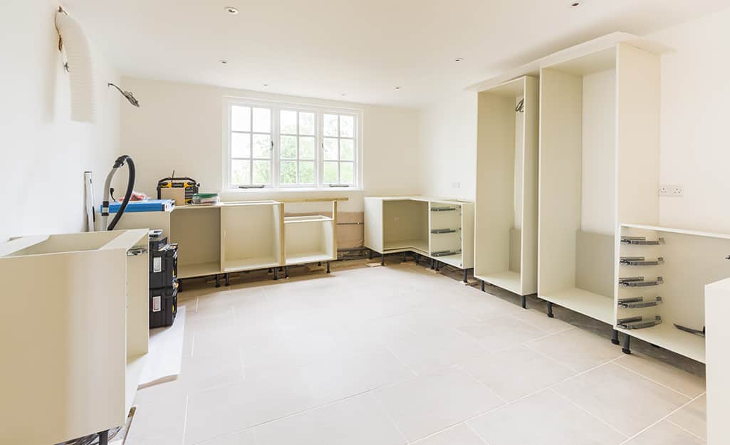 Cabinets with doors off and drawers removed.