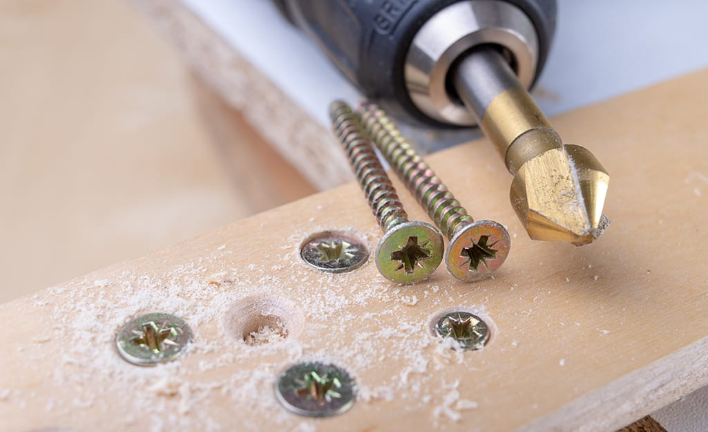 A drill with screws.