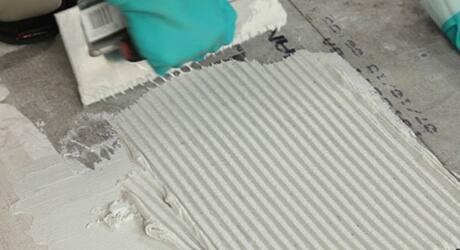 Man making uniform ridges.