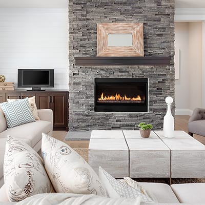 A gas fireplace makes a living room more warm and cozy.