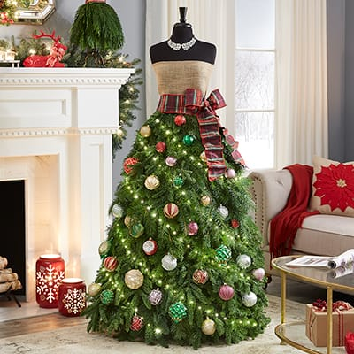 A dress form Christmas tree with ornaments