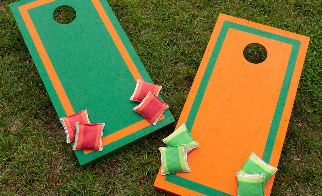 A pair of finished cornhole boards with bean bags.