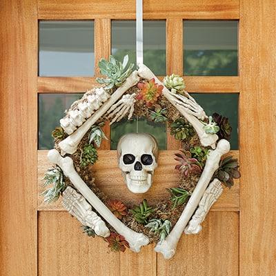 A skeleton wreath hanging on a front door.