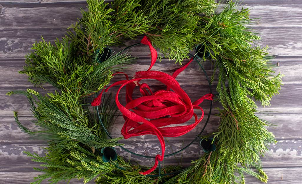 A wreath made with fresh greenery.