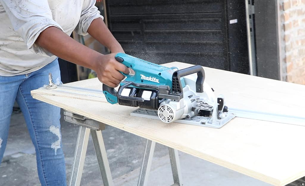 A circular saw is used to cut wood.