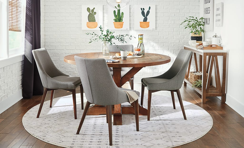 A wood dining table with upholstered chairs.