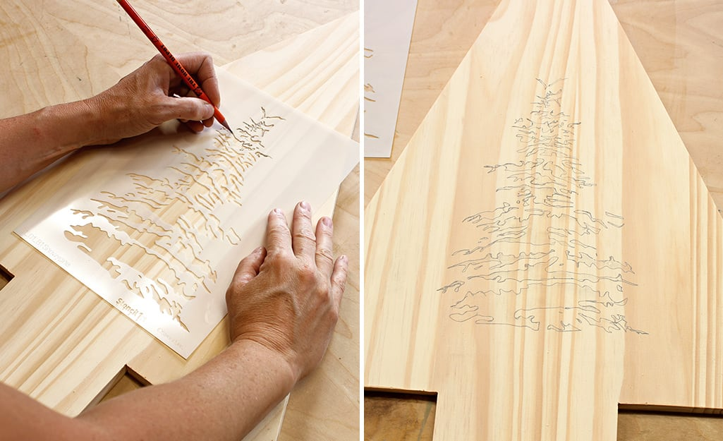 A person uses a stencil and a pencil to trace a design onto the board.