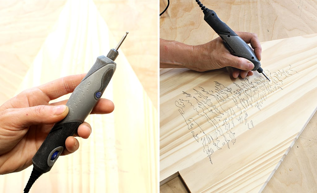 A person uses a rotary tool to carve the design into the board.