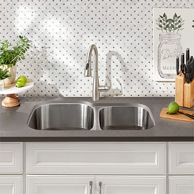 A stainless steel double bowl sink.