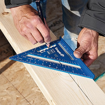A person using a speed square.