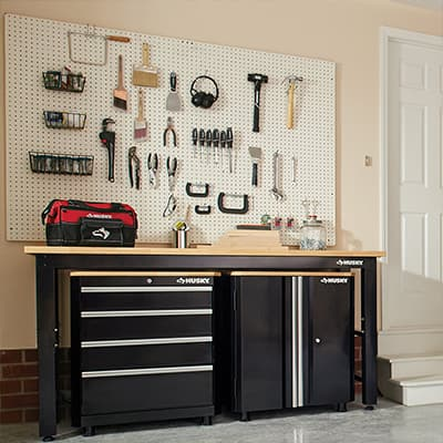 a pegboard with organized tools in a garage