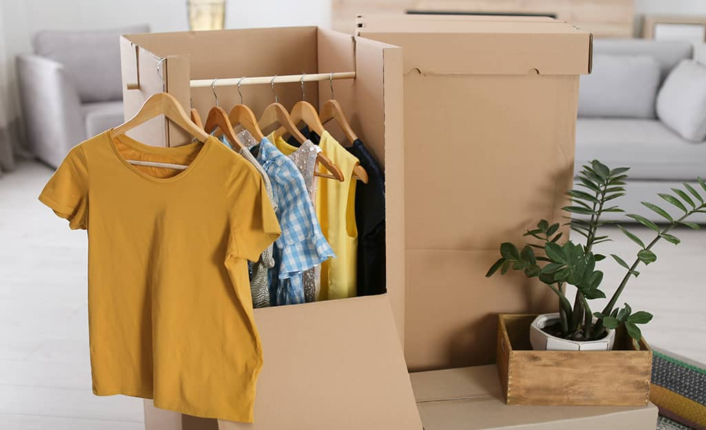 Clothes hanging in a wardrobe box.