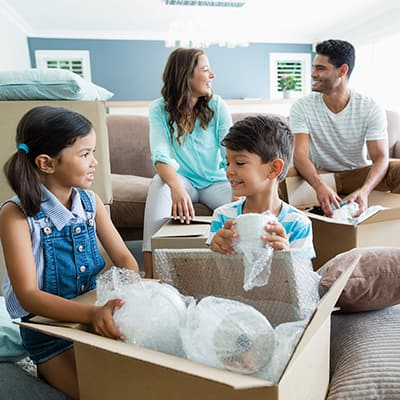 Family packing a living room.