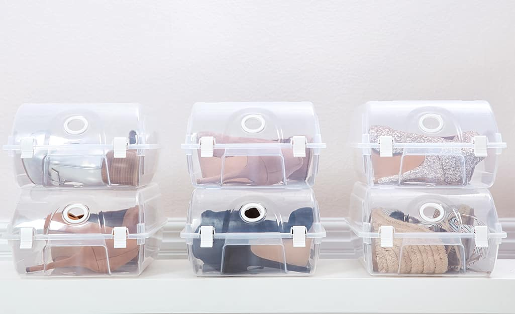 Shoes placed in clear plastic storage containers.