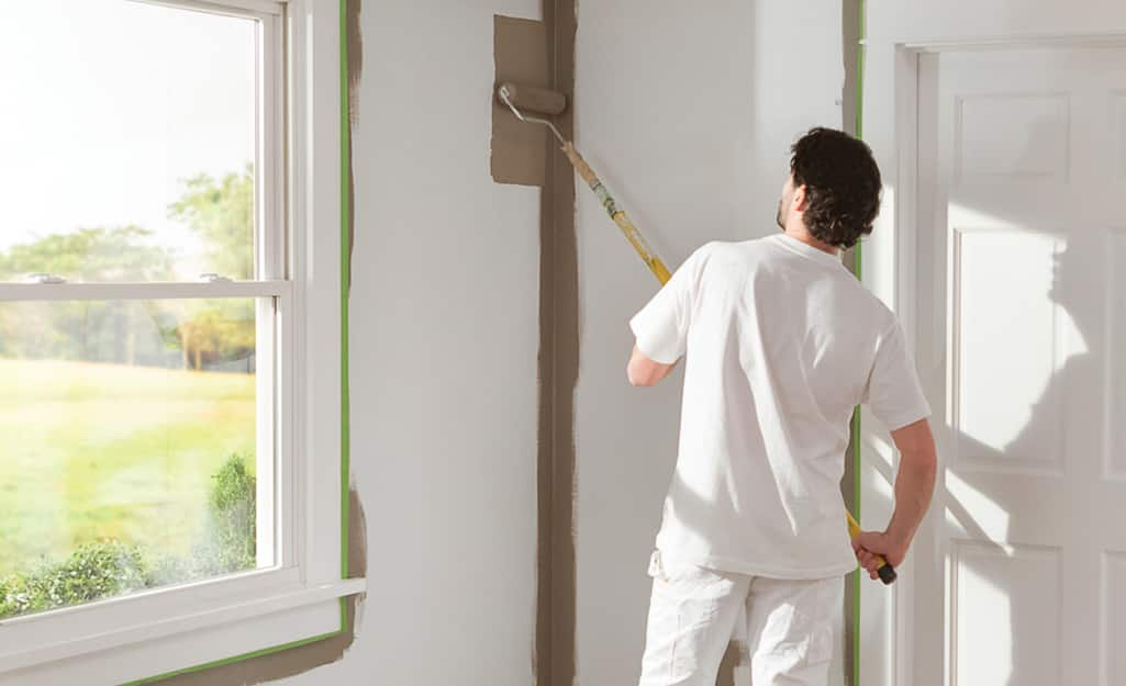 A person painting a wall.