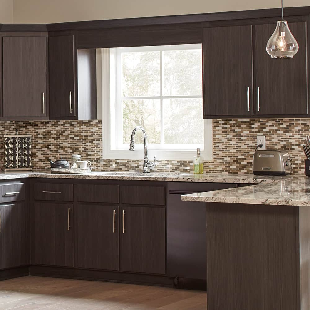 Refaced kitchen cabinets in a large kitchen.