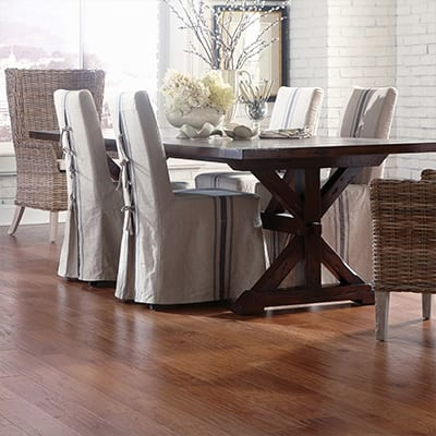 dining room with table and chairs and a finished hardwood floor