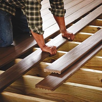 Man repairing a deck.
