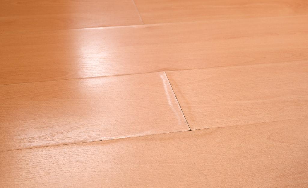 To Replace Laminate Flooring, Warped Laminate Flooring Repair