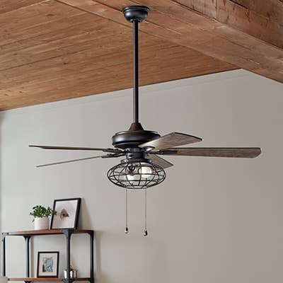 a ceiling fan hanging in a living space
