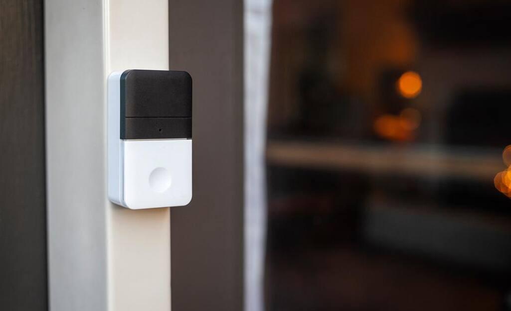 A wireless doorbell installed at a front door.