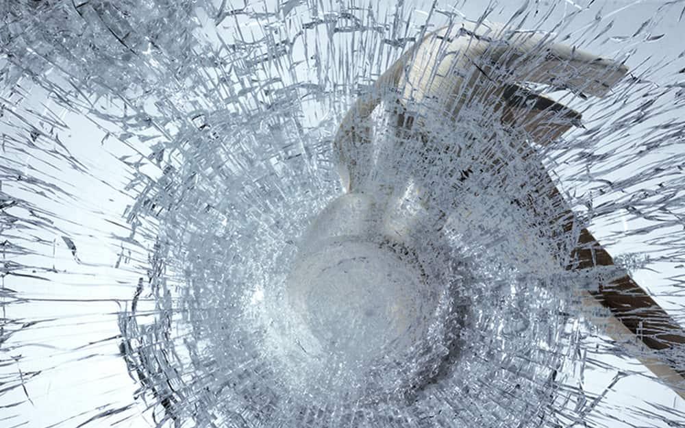hammer breaking window glass