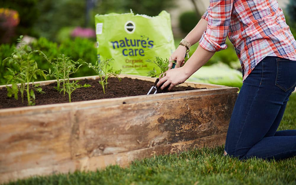 Adding soil to a raised bed