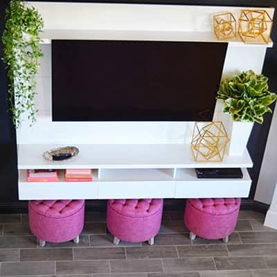A flatscreen TV displayed on a white entertainment center.