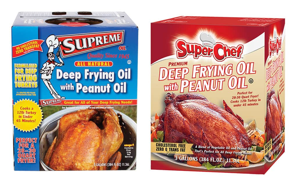 Two containers of deep frying oil with peanut oil.