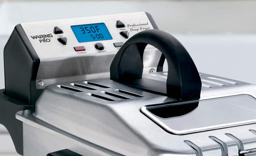 A deep fryer with a digital temperature display on the control panel.