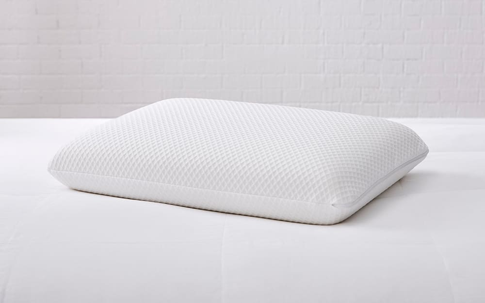 A memory foam pillow on a bed.