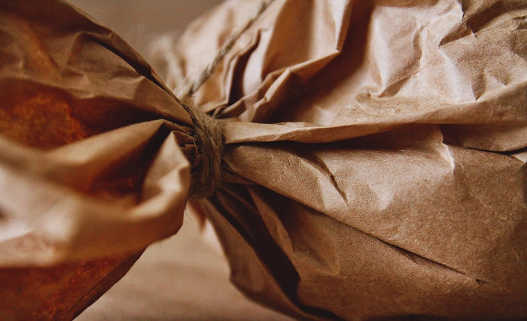Brown paper wrapped around a gift and tied with string.