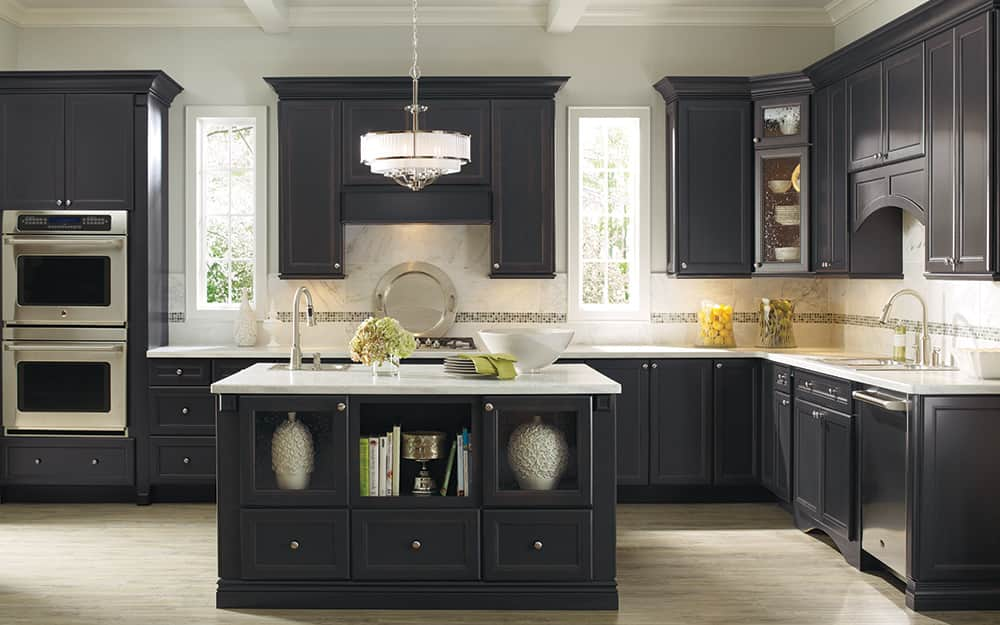 a kitchen featuring custom cabinets