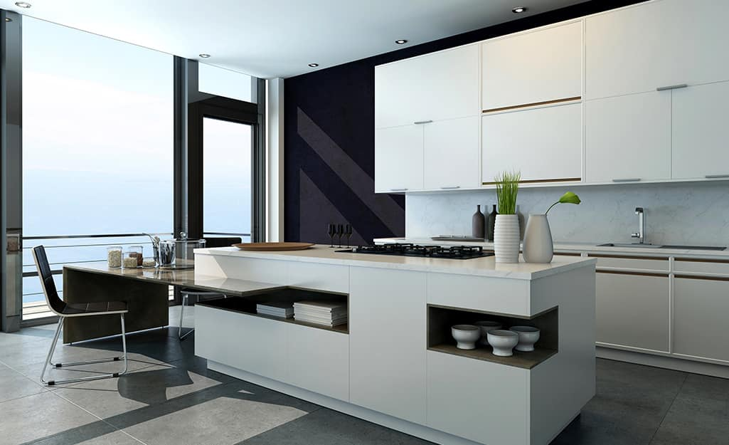 A kitchen featuring white cabinets and black accents.