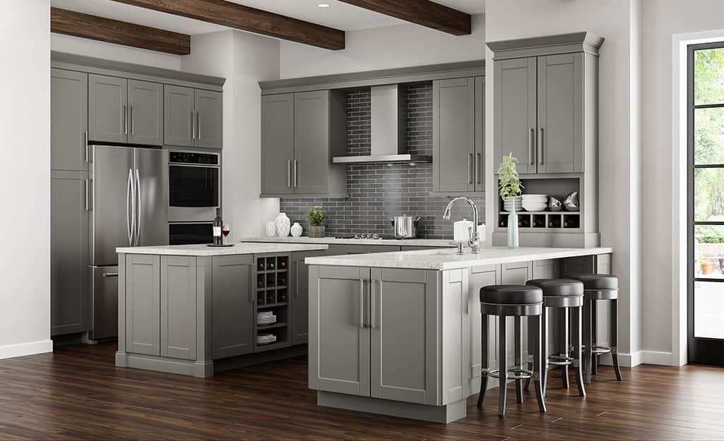 Two islands make up an open kitchen cabinet layout.